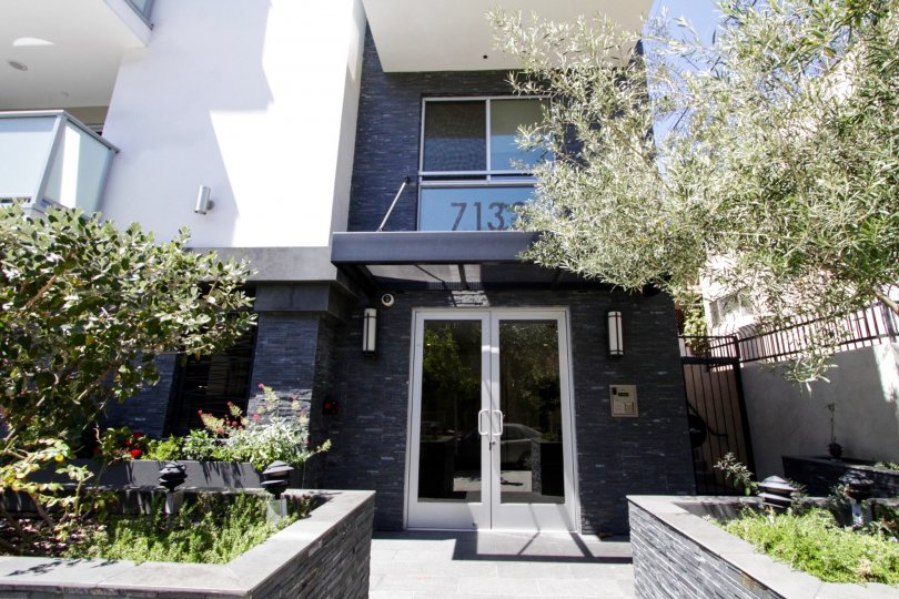 Stacked slate stone wraps the raised planters and accents the front entrance to Hawthorn in Hollywood