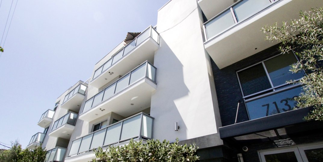 A modern flair embodies Hawthorn in Hollywood with white stucco, glass balconies and stacked stone