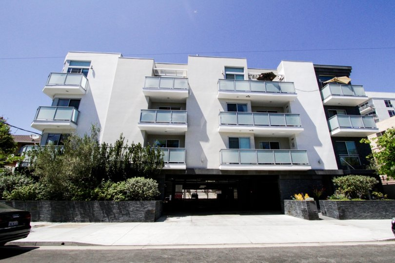 Hawthorn in Hollywood is a beautiful white stucco building with glass and stone accents