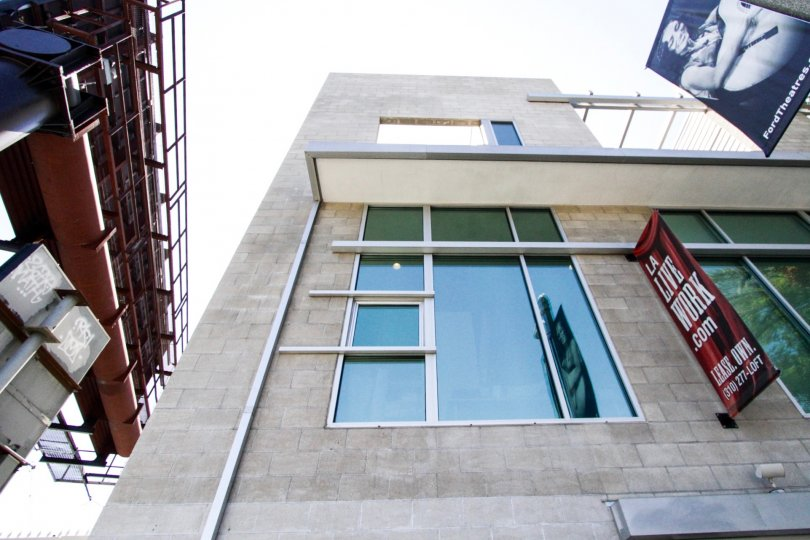 Staring directly up at Highland Lofts shows the large windows and block construction of the building
