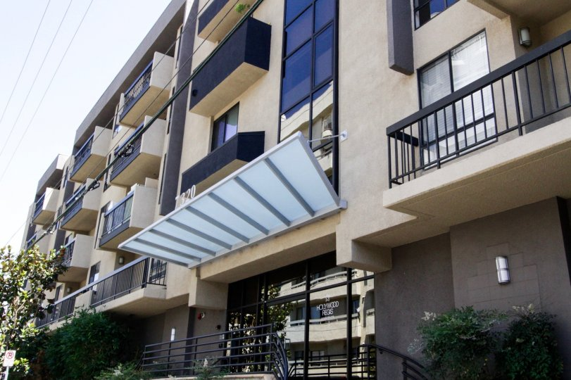 A frosted glass and metal awning cover the Hollywood Regis entry