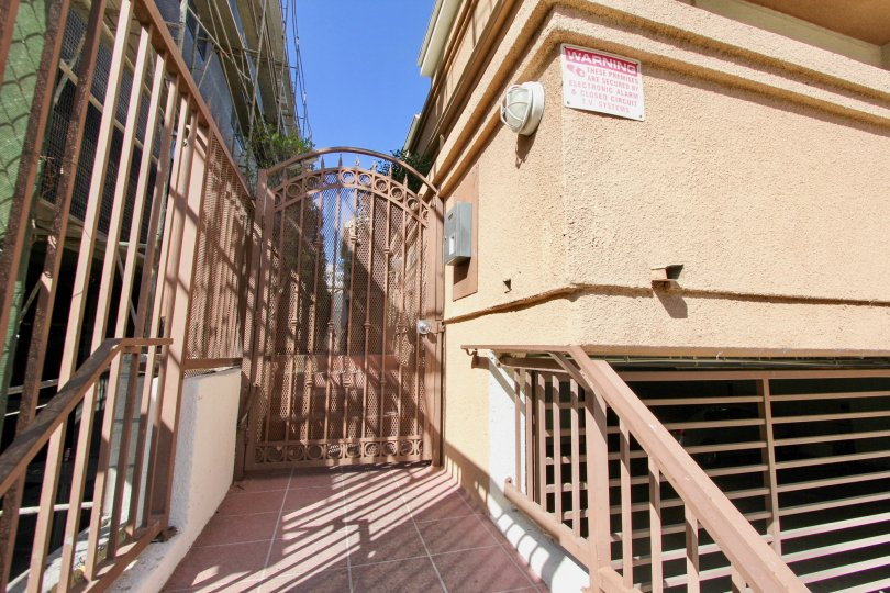 The gated entrance on the side of Hudson Terrace