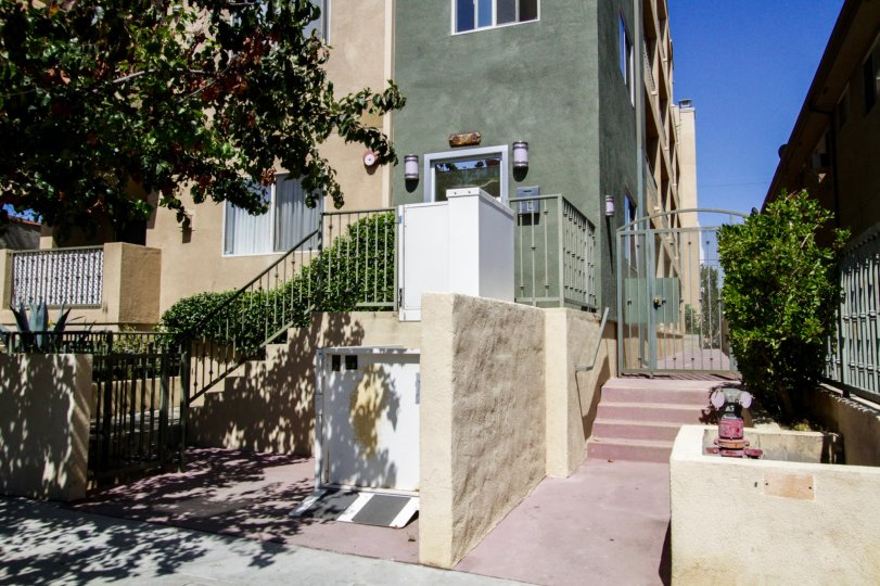 Stairs lead to the front and side entrance to Hudson Villas in Hollywood