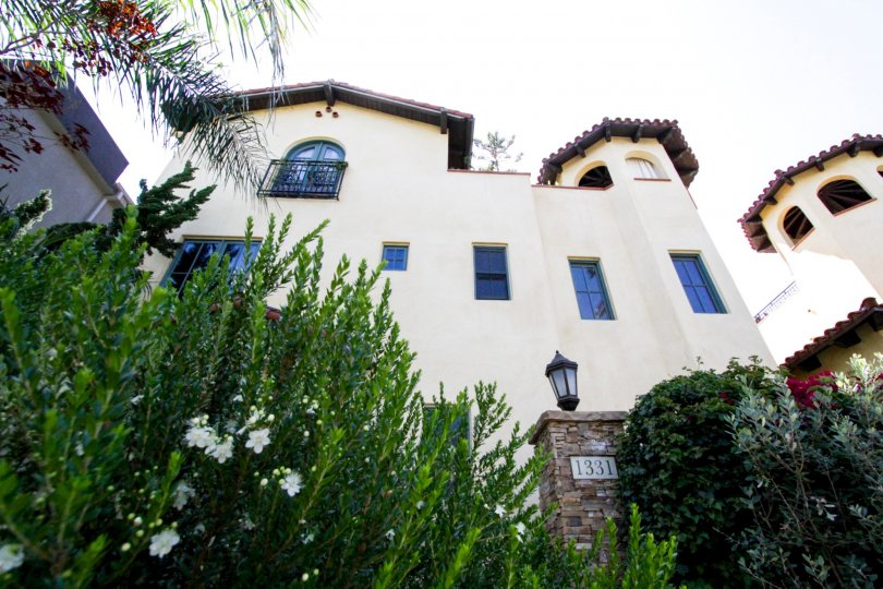 La Serenata is lushly landscaped with bushes and flowers throughout