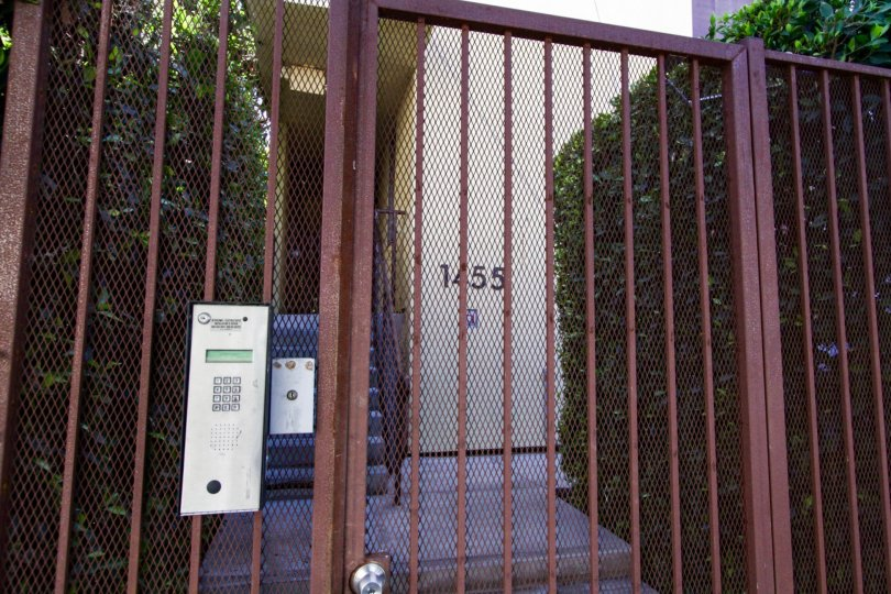 A rusted metal gate leads to the entrance of Sunset Blvd Lofts at Bronson