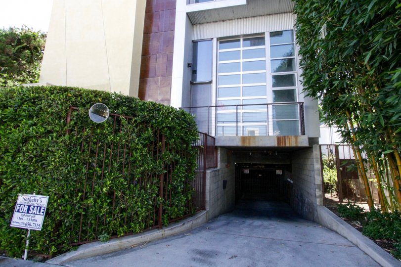 Underground gated parking entrance to Sunset Blvd Lofts at Bronson