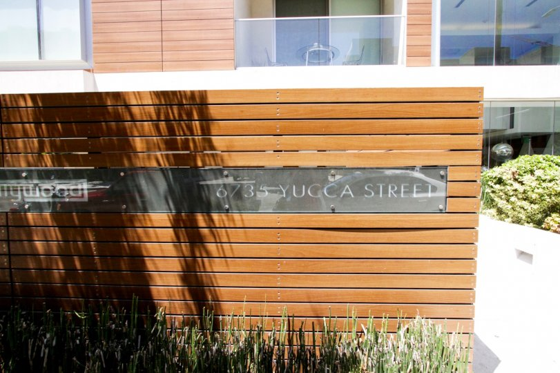 The Hollywood address in a front wood wall