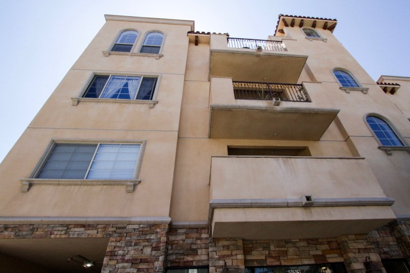 Villa La Pietra is a midrise condo building with arched windows