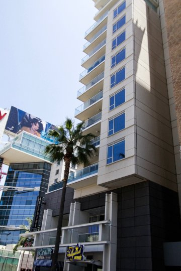 At the corner of the W Hollywood Residences building glass balconies ascend to the top