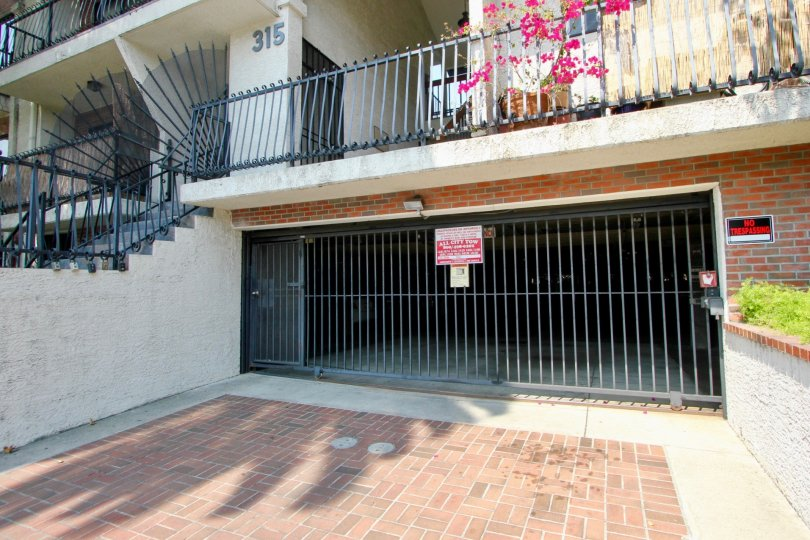 A sunny day at Harvard Gardens Apartments with stairs and parking garage