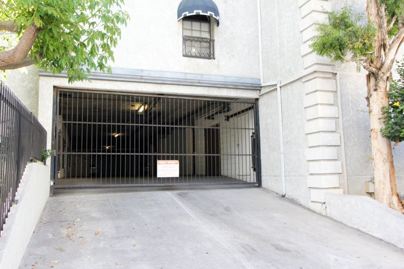 Daylight scene of the garage entrance to Kenmore Manor with gate down to prevent access.