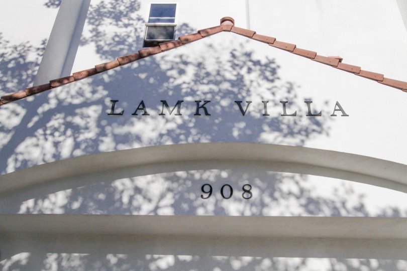Black letters above the entry to Lamk Villa bare the building name