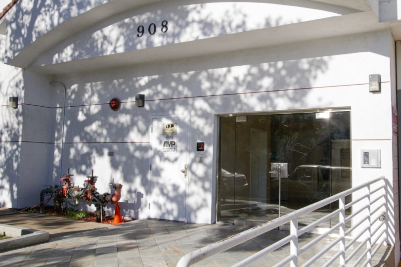 Double glass doors lead to the entrance of Lamk Villa condos