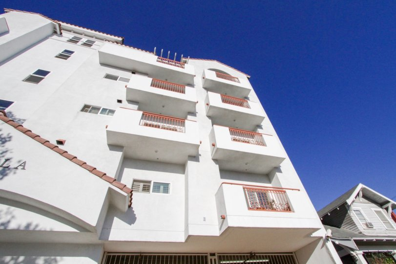 The side of the Lamk Villa building shows balconies at each floor
