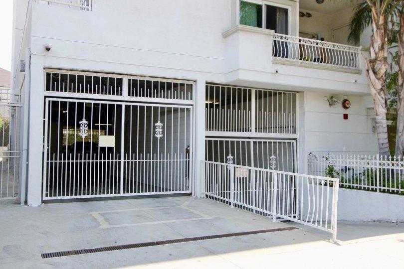 Partial view of Manhattan Villa and gates in Koreatown, CA