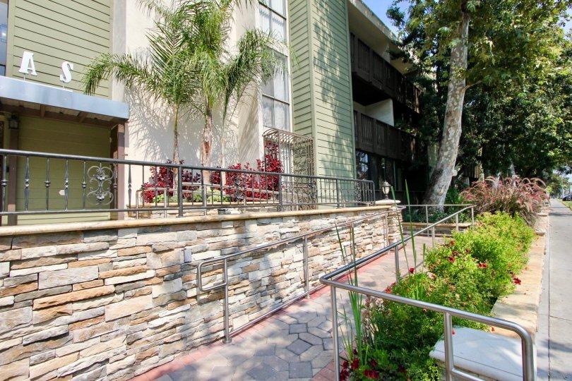 Walkway with bushes near Park Villas in Koreatown California