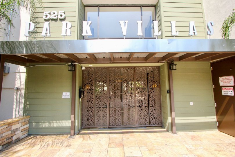 Front entrance at Park Villas with beautifully designed doors and a big Park Villas sign and big window.