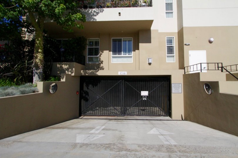Two gates lead in and out from the gated parking garage for Wilton Villas