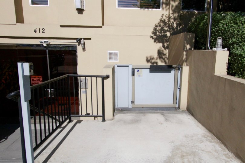 A wheelchair elevator to the right of the stairs at Wilton Villas