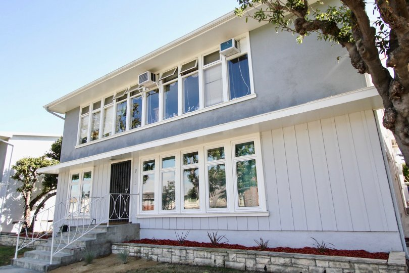 The windows in the building at 1014 E Carson St in Long Beach, California