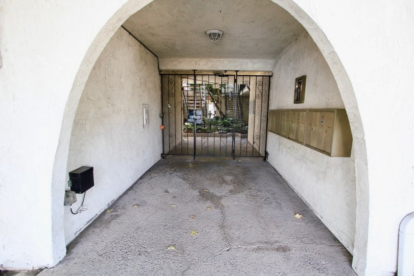The security gate for access into 360 Gladys Ave in Long Beach, California