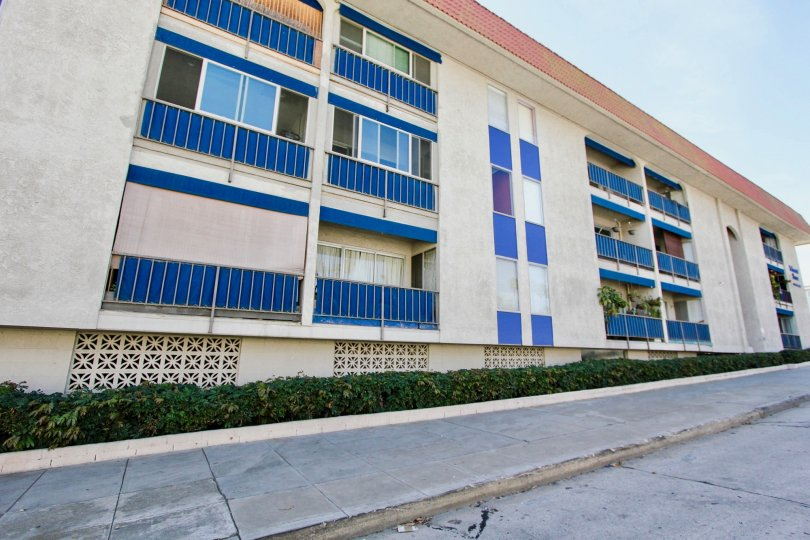 The blue décor on the Belmont Shore Condominiums building