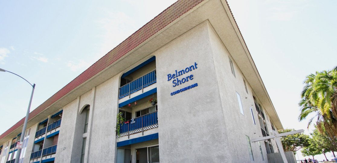 The name of Belmont Shore Condominiums on the building