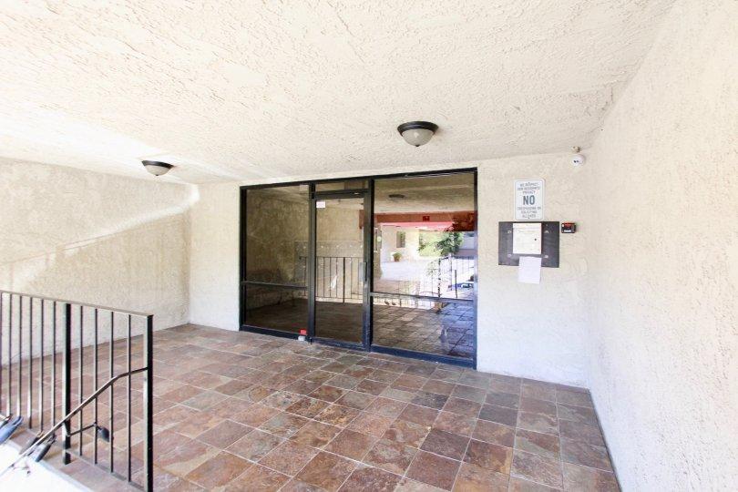 The entrance into Bixby Elm Condominiums