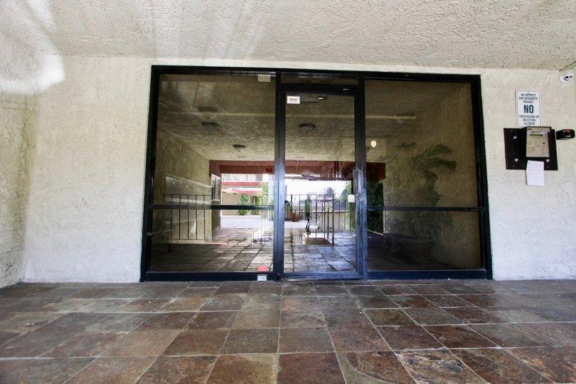 The entryway into Bixby Elm Condominiums in Long Beach, California