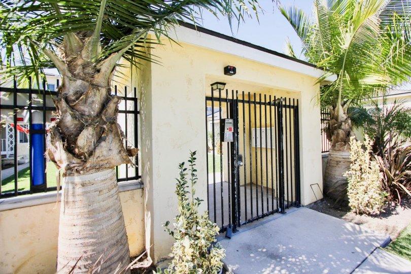 The gate into Clark Avenue Villas