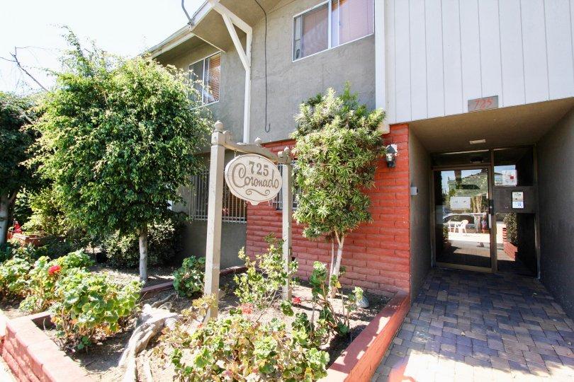 The driveway into Coronado Manor in Long Beach, California