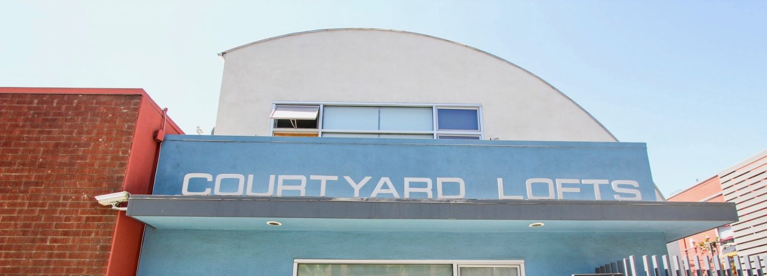 The Courtyard Lofts name above the entrance