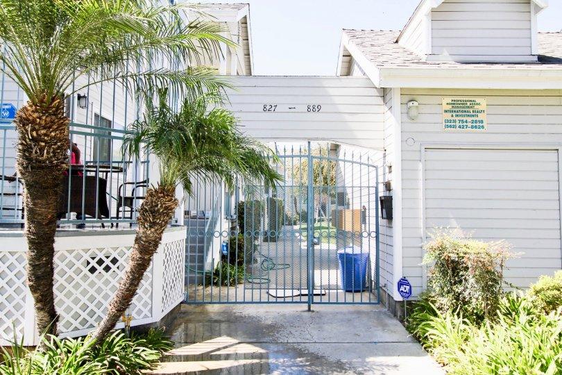 The gate into Drake Village in Long Beach, California