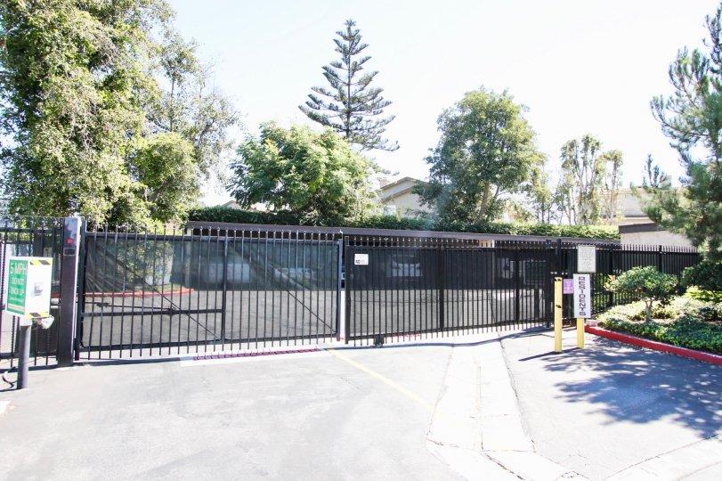 The gate into El Dorado Lakes in Long Beach, California