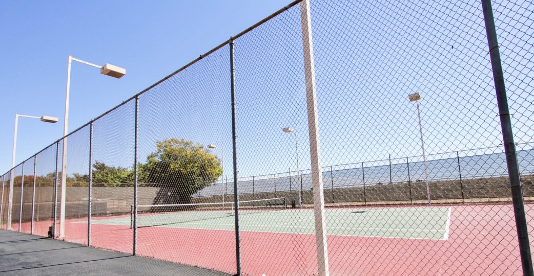 The fence around the courts at El Dorado Lakes