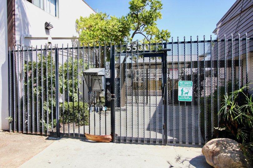 The gate for access into Hampton Condominium