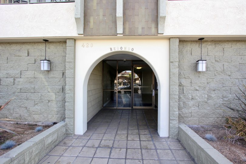 The entrance into Redondo Plaza Condominiums