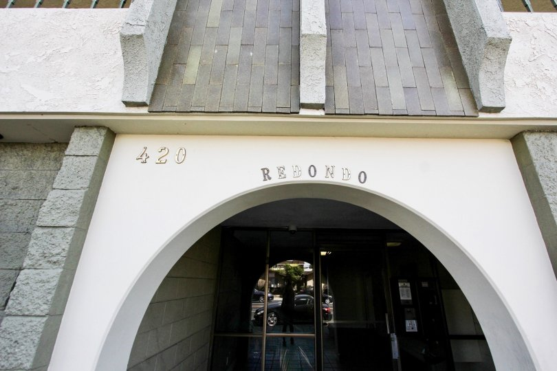 The address for Redondo Plaza Condominiums on the building