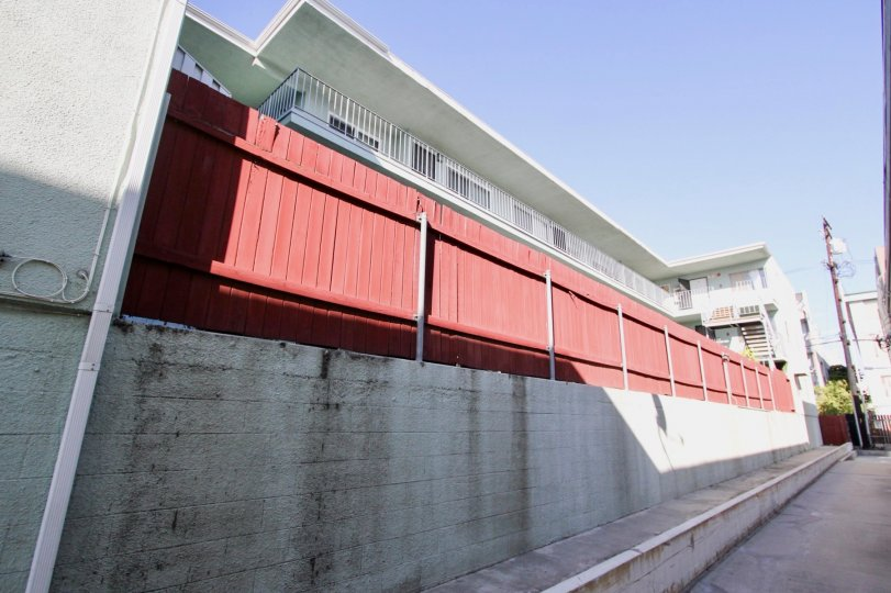 The red fence around Royal Elm for privacy