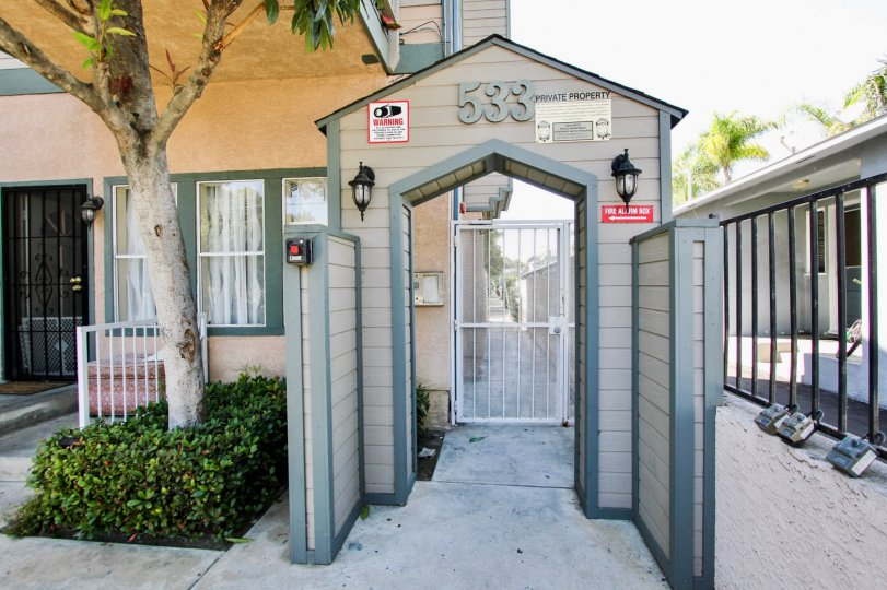 The address above the entrance into Walnut Ave Villas located in Long Beach, California
