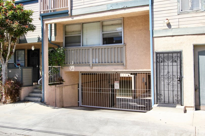 The gate for parking at Walnut Ave Villas in Long Beach, California