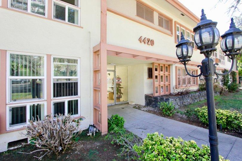 The sidewalk into Franklin Manor in Los Feliz, California