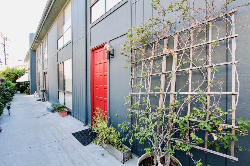 A red door seen at 12772 Pacific Ave