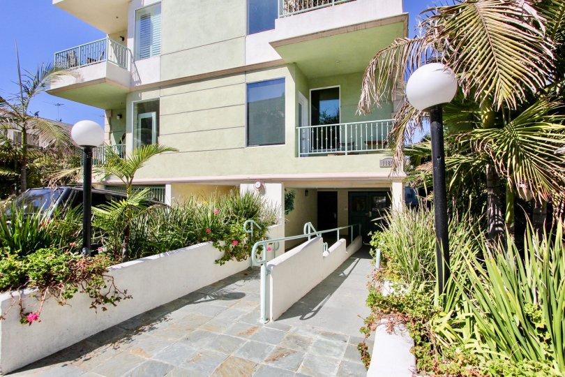 The sidewalk in front of Avon Villas