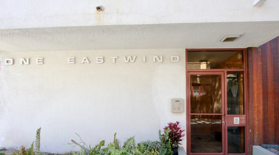 A view of 1 Eastwind, a building with a clean, modern streamlined look.
