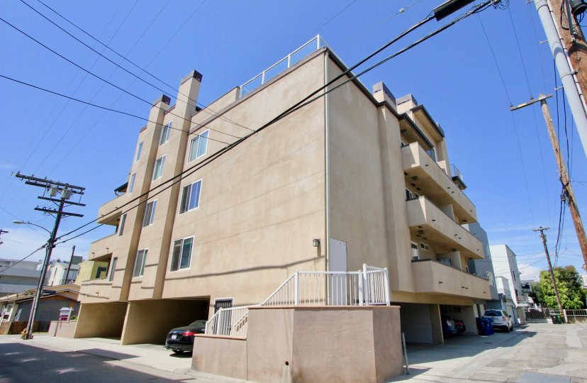 A lovely day on 16 Quarterdeck, a residential building with covered parking and a modern feel.