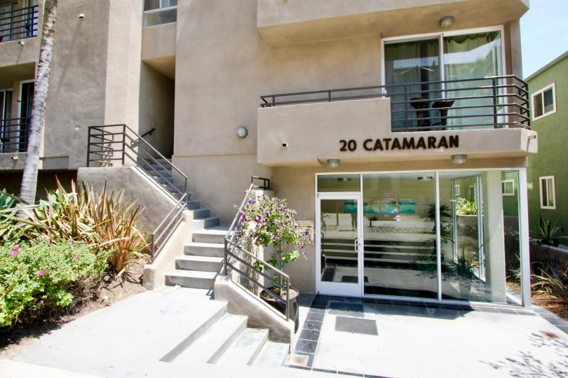 A sunny day at 20 Catamaran in Marina Del Ray in California with condominium building showing interior of one condo