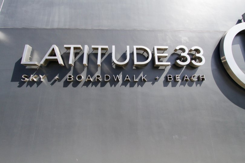 The name of Latitude 33 Beach Collection on the building