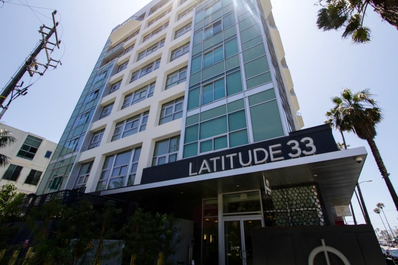 The name of the Latitude 33 Sky Collection building above the entrance