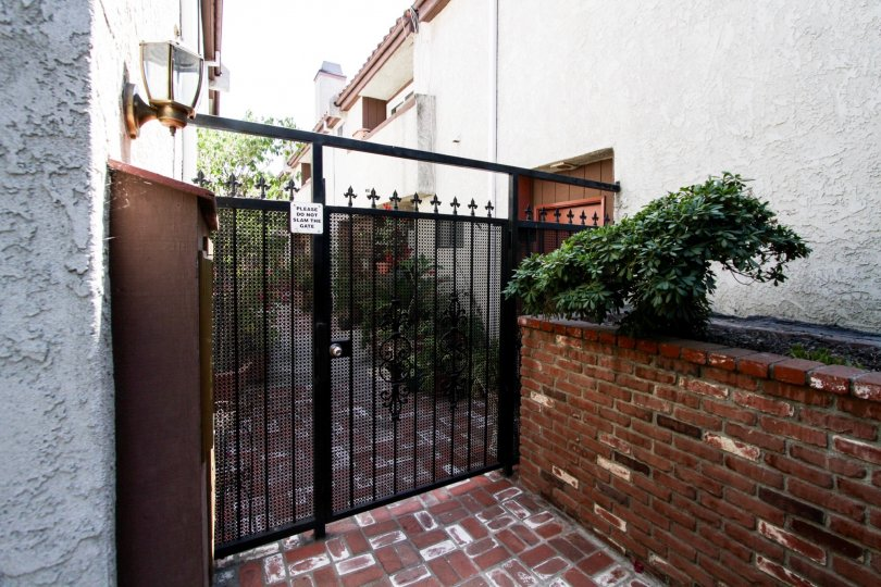 The gated entrance into 11154 Huston St
